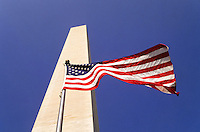 Washington Monument with a flag in Washington DC, USA