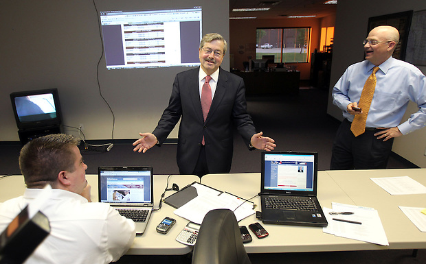 Terry Branstad talks with his staff while awaiting the Republican primary election results Tuesday night, June 8, 2010, at his campaign headquarters in Urbandale.   At right is his campaign manager,  Jeff Boeyink.