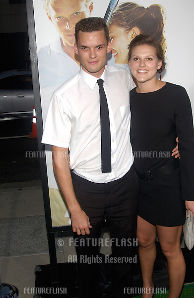 Actor AUSTIN NICHOLS & girlfriend at the world premiere, in Beverly Hills, of his new movie romantic tennis comedy Wimbledon..September 13, 2004