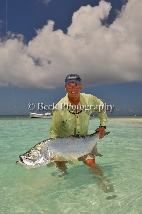 BARRY BECK WITH A TARPON CAUGHT FLY FISHING