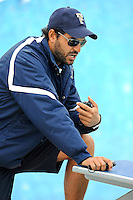 14 January 2012:  FIU Assistant Coach Ignacio Gayo puts swimmers through warm-ups prior to the meet.  The FIU Golden Panthers won the meet with the Central Connecticut State University Blue Devils at the Biscayne Bay Campus Aquatics Center in Miami, Florida.