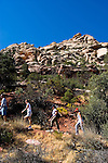 People hiking Willow Springs Trail in Red Rock State Park near Las Vegas, Nevada, NV, one man hiker, three women hikers, hiking, hiking path, image nv404-18436 .Photo copyright: Lee Foster, www.fostertravel.com, lee@fostertravel.com, 510-549-2202