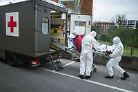 Switzerland. Canton Ticino. Lugano. Due to the spread of the coronavirus (also called Covid-19) and given the increase in cases in Ticino, the Clinica Luganese Moncucco welcomes patients affected by the coronavirus. A military ambulance brings a coronavirus patient to the Clinica Luganese Moncucco which works as Covid-19 Hospital. A soldier opens the ambulance door while two nurses pulled down an emergency medical stretcher. 22.03.2020 © 2020 Didier Ruef