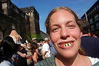 "PHILADELPHIA - JULY 10: Devon Lipsky, of Philadelphia, Pennsylvania celebrates Philadelphia's 10th Annual Bastille Day as a wench at Eastern State Penitentiary July 10, 2004 in Philadelphia, Pennsylvania. Hundreds attended the event to see a re-enactment of the storming of the Bastille, and Marie Antoinette declare ""Let them eat cake!"" and throw Hostess Twinkies into the crowd.  (Photo by William Thomas Cain/Getty Images)"