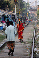 A woman walks along train tracks in central Kolkata.<br /> <br /> To license this image, please contact the National Geographic Creative Collection:<br /> <br /> Image ID: 1925778 <br />  <br /> Email: natgeocreative@ngs.org<br /> <br /> Telephone: 202 857 7537 / Toll Free 800 434 2244<br /> <br /> National Geographic Creative<br /> 1145 17th St NW, Washington DC 20036