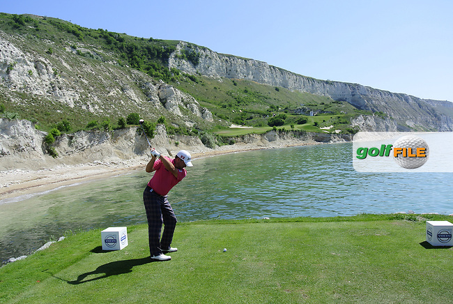 Graeme McDowell (NIR) tees off the sea bound 9th tee box during Sunday morning's Semi Finals of the 2013 Volvo World Matchplay Championship held  at the Thracian Cliffs Golf & Beach Resort, Kavarna, Bulgaria, 19th May 2013..Picture: Eoin Clarke www.golffile.ie.