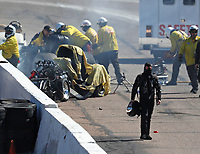 Feb 25, 2018; Chandler, AZ, USA; NHRA funny car driver Jonnie Lindberg walks away from his car after crashing with John Force during the Arizona Nationals at Wild Horse Pass Motorsports Park. Mandatory Credit: Mark J. Rebilas-USA TODAY Sports