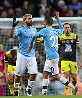 2nd November 2019; Etihad Stadium, Manchester, Lancashire, England; English Premier League Football, Manchester City versus Southampton; Bernardo Silva of Manchester City high fives goalscorer Sergio Aguero after his 70th minute equaliser - Strictly Editorial Use Only. No use with unauthorized audio, video, data, fixture lists, club/league logos or 'live' services. Online in-match use limited to 120 images, no video emulation. No use in betting, games or single club/league/player publications