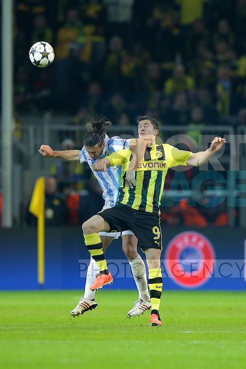 Robert LEWANDOWSKI (Borussia Dortmund - BVB - 9) - Martin DEMICHELIS, Martin Gaston DEMICHELIS (FC Malaga - 5)..