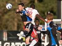 Bobby Burling of Earthquakes battles for the ball in the air against Salou Ibrahim of Red Bull at Buck Shaw Stadium in Santa Clara, California.  San Jose Earthquakes defeated New York Red Bulls, 4-0.