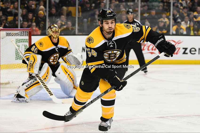 January 3, 2015 - Boston, Massachusetts, U.S. - Boston Bruins defenseman Adam McQuaid (54) in game action during the NHL game between the Ottawa Senators and the Boston Bruins held at TD Garden in Boston Massachusetts. Eric Canha/CSM