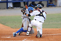 Outfielder Cam Connor (30) of the Burlington Royals is tagged out by catcher Cam Maron (7) of the Kingsport Mets in a game on August 20, 2011, at Hunter Wright Stadium in Kingsport, Tennessee. Kingsport defeated Burlington, 17-14. (Tom Priddy/Four Seam Images)