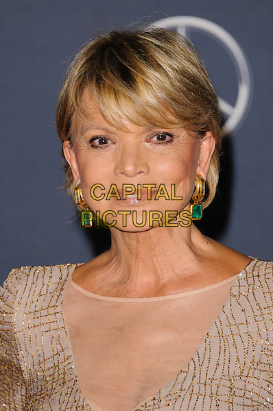 Uschi Glas .Arrivals at the Laureus 2012 World Sports Awards held at the Queen Elizabeth II Centre, London, England..February 6th, 2012.headshot portrait beige green earrings gold   .CAP/CJ.©Chris Joseph/Capital Pictures.