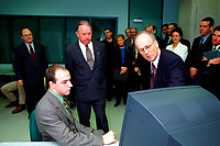 ID :  pr_99-09-30-D<br /> 1999 File photo of Quebec's  new Premier, the Honorable Bernard Landry (3rd from left, looking down at the computer) at the inauguration of CAMAQ program in Montreal, Sept 30, 1999.<br /> Acclaimed with no opposition  as PQ leader on march 2,2001, he will be officially assermented this Thursday , March 8, 2001 as Quebec Premier.<br /> Landry 63, was the only candidate to replace Lucien Bouchard who resigned for personnal reasons. <br /> Photo by Pierre Roussel / Liaison<br /> <br /> NOTE : scans from photo CD