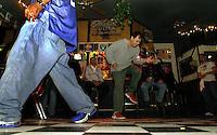 11:29 PM: ROGER MAREZ of Pleasanton dances to AC/DC during karaoke night at the Union Jack Pub in Pleasanton, Calif., Thursday Oct. 21, 2004.