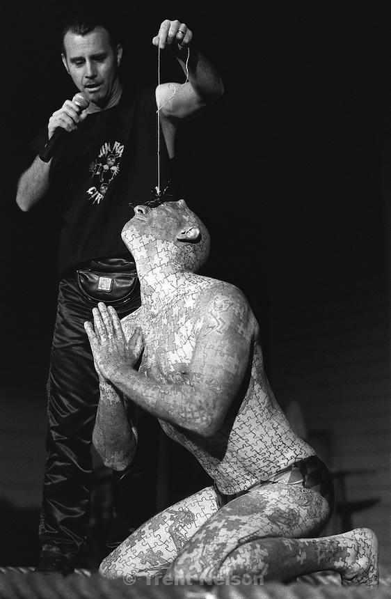 Jim Rose holds a live scorpion on the face of The Enigma during the Jim Rose Circus at Brick's.