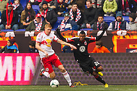 Markus Holgersson (5) of the New York Red Bulls and Lionard Pajoy (26) of D. C. United. The New York Red Bulls and D. C. United played to a 0-0 tie during a Major League Soccer (MLS) match at Red Bull Arena in Harrison, NJ, on March 16, 2013.
