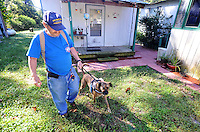 NWA Democrat-Gazette/MICHAEL WOODS • @NWAMICHAELW<br /> Richard Ellett, a veteran with PTSD,  walks Tiger, his service dog around his home Saturday September 12, 2015. Tiger, a service dog,  was given to Ellett by Soldier ON,  a new non-profit that places puppies with puppy-raisers for one year to be trained as service dogs, to then be given to veterans with PTSD.