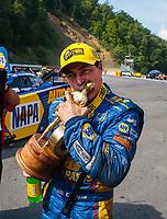 Jun 17, 2018; Bristol, TN, USA; NHRA funny car driver Ron Capps celebrates after winning the Thunder Valley Nationals at Bristol Dragway. Mandatory Credit: Mark J. Rebilas-USA TODAY Sports
