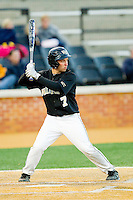 Joey Rodriguez (7) of the Wake Forest Demon Deacons at bat against the West Virginia Mountaineers at Wake Forest Baseball Park on February 24, 2013 in Winston-Salem, North Carolina.  The Demon Deacons defeated the Mountaineers 11-3.  (Brian Westerholt/Four Seam Images)