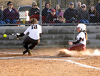 Westside Eagle Observer/RANDY MOLL<br /> Gentry's Mandy Barber slides across home plate while Siloam Springs' pitcher Jessie Robinson waits for the throw from the catcher during play on Thursday (March 1, 2018) at Gentry High School.