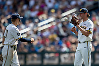 Michigan Wolverines pitcher Jeff Criswell (17) and third baseman Blake Nelson (10) during Game 1 of the NCAA College World Series against the Texas Tech Red Raiders on June 15, 2019 at TD Ameritrade Park in Omaha, Nebraska. Michigan defeated Texas Tech 5-3. (Andrew Woolley/Four Seam Images)
