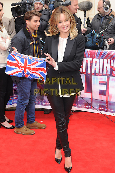 Amanda Holden .attends the Britain's Got Talent launch, at The ICA, London, England, UK, 11th April 2013..full length black suit blazer jacket trousers white top leather pants tuxedo holding union jack flack underpants pants underwear boxer shorts .CAP/BEL.©Tom Belcher/Capital Pictures.