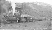 Wide angle fireman side view of RGS #74 with a southbound stock train taking water at Coke Ovens.<br /> RGS  Coke Ovens, CO  Taken by Richardson, Robert W. - 9/25/1951
