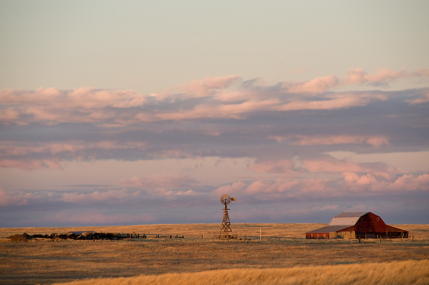 The sun sets on a ranch in southeastern Wyoming, home of some of the nation's grand champion winds. Wind energy companies have been scrambling across Wyoming's notoriously windy eastern plains hoping to sign up ranchers for access to install trubines for electricity generation. Many of the ranchers are uncharacteristically banding together to negotiate for better prices for the access. (Kevin Moloney for the New York Times)