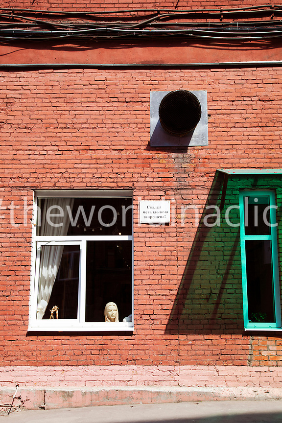 RUSSIA, Moscow. A window of a shop in the old Red October Chocolate Factory. The buildings now houses a variety of clubs, restaurants and galleries.