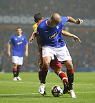 Madjid Bougherra tries to walk the ball out of defence and trips up over Adriano