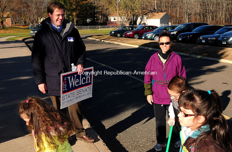 BRISTOL, CT, 06 NOV 12-11062AJ06- Sen. Jason C. Welch, R-Bristol, speaks with Teresa Acampora and her children while campaigning for reelection to the 31st Senate District in Bristol Tuesday afternoon.  Alec Johnson/ Republican-American