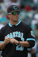 The Coastal Carolina University Chanticleers outfielder Hayes Orton #23in the dugout during the 2nd and deciding game of the NCAA Super Regional vs. the University of South Carolina Gamecocks on June 13, 2010 at BB&T Coastal Field in Myrtle Beach, SC.  The Gamecocks defeated Coastal Carolina 10-9 to advance to the 2010 NCAA College World Series in Omaha, Nebraska. Photo By Robert Gurganus/Four Seam Images