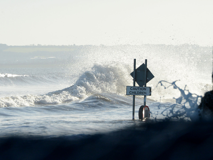 Large waves at high tide at Bettystown beach on Saturday morning. Photo: Colin Bell/pressphotos.ie