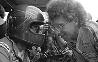John Paul Jr, left and Rolf Stommelen talk in the pits during the Rolex 24 at Daytona, Daytona International Speedway, Daytona Beach, FL, January 31, 1982.  (Photo by Brian Cleary/www.bcpix.com)