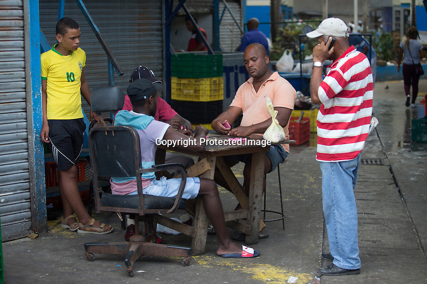 18/02/16 <br /> <br /> Men play dominoes at Panama City fish market, Panama.<br /> <br /> All Rights Reserved: F Stop Press Ltd. +44(0)1335 418365   +44 (0)7765 242650 www.fstoppress.com