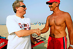 Gary Mottola of Madison Marquette (left) shakes hands with Joe Bongiovanni, Asbury Park beach safety supervisor, during action at the First Annual Asbury Park Beach Bar Lifeguard Competition held at the 3rd Avenue beach in Asbury Park.  ASBURY PARK, NJ  8/4/07  8:21:47 PM  PHOTO BY ANDREW MILLS