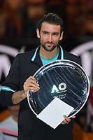 January 28, 2018: Number six seed Marin Cilic of Croatia accepts the runners up trophy after losing the Men's Final against on day fourteen of the 2018 Australian Open Grand Slam tennis tournament in Melbourne, Australia. Federer won 3 sets to 2. Photo Sydney Low