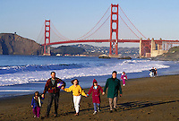 CAUCASIAN FAMILY STROLLING ALONG BAKER BEACH NEAR GOLDEN GATE BRIDGE. CAUCASIAN FAMILY. SAN FRANCISCO CALIFORNIA USA.