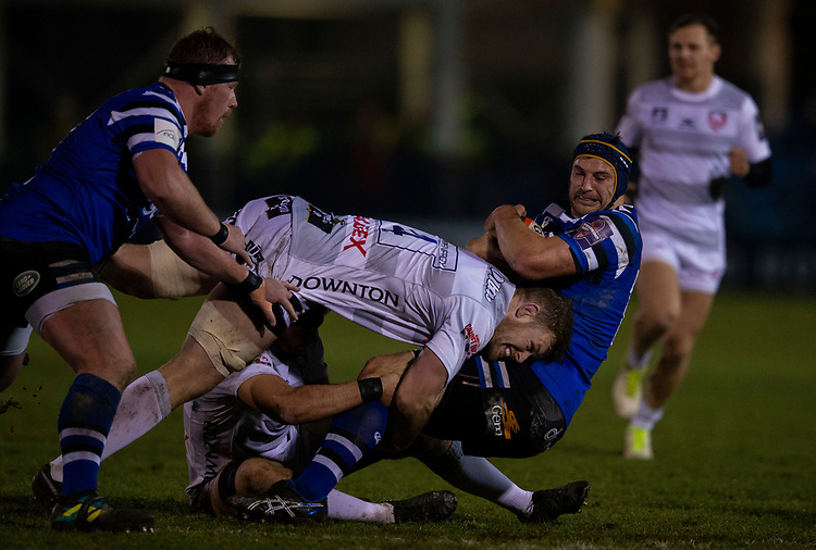 Bath Rugby's Paul Grant is tackled by Gloucester's Tom Savage<br /> <br /> Photographer Bob Bradford/CameraSport<br /> <br /> Gallagher Premiership - Bath Rugby v Gloucester Rugby - Monday 4th February 2019 - The Recreation Ground - Bath<br /> <br /> World Copyright &copy; 2019 CameraSport. All rights reserved. 43 Linden Ave. Countesthorpe. Leicester. England. LE8 5PG - Tel: +44 (0) 116 277 4147 - admin@camerasport.com - www.camerasport.com