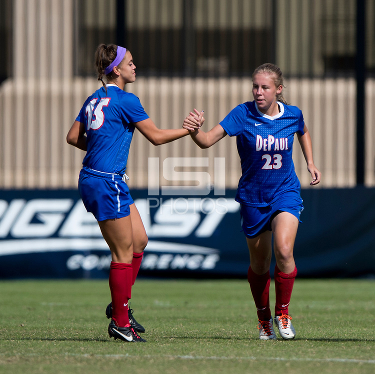 Ashleigh Goddard (23) of DePaul celebrates a goal with teammate Kylie Nordness (15) during the game at Shaw Field on the campus of Georgetown University in Washington, DC.  Georgetown tied DePaul, 1-1, in double overtime.