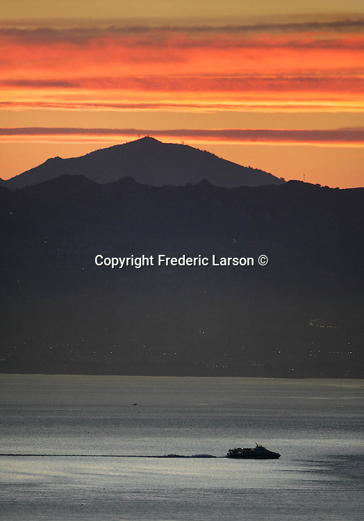 Mount Diablo was topped off by bands of clouds during sunrise seen from the Marin headlands.. ...