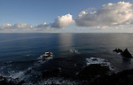 Early morning clouds reflected in the sea, Benijo, Tenerife, Canary Islands,