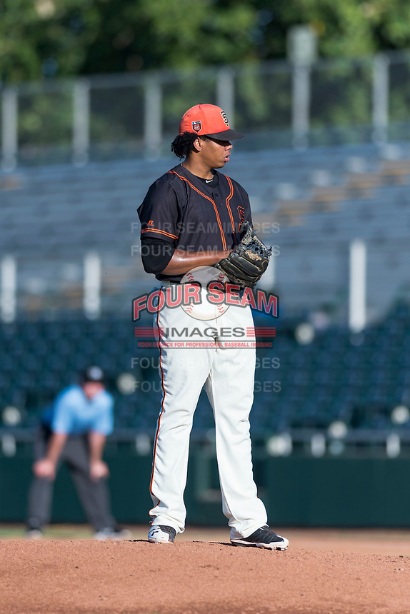 AZL Giants Orange starting pitcher Johan Herrera (40) looks in for the sign during an Arizona League game against the AZL Rangers at Scottsdale Stadium on August 4, 2018 in Scottsdale, Arizona. The AZL Giants Black defeated the AZL Rangers by a score of 3-2 in the first game of a doubleheader. (Zachary Lucy/Four Seam Images)