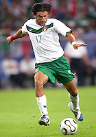 Jose Fonseca (17) of Mexico winds up a shot. Portugal defeated Mexico 2-1 in their FIFA World Cup Group D match at FIFA World Cup Stadium, Gelsenkirchen, Germany, June 21, 2006.