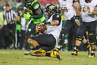 Tampa, FL - September 2, 2016: Towson Tigers quarterback Morgan Mahalak (6) slides for a touchdown during game between Towson and USF at the Raymond James Stadium in Tampa, FL. September 2, 2016.  (Photo by Elliott Brown/Media Images International)