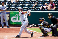 Spiker Helms (9) of the Missouri State Bears swings hard at a pitch during a game against the Wichita State Shockers in the 2012 Missouri Valley Conference Championship Tournament at Hammons Field on May 23, 2012 in Springfield, Missouri. (David Welker/Four Seam Images)