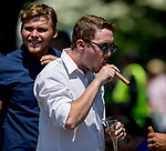 ELMONT, NY - JUNE 09: A fan enjoys a cigar on Belmont Stakes Day at during Belmont Stakes Day at Belmont Park on June 9, 2018 in Elmont, New York. (Photo by Eric Patterson/Eclipse Sportswire/Getty Images)