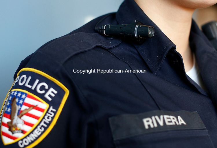 Watertown, CT- 13 February 2015-021315CM02-<br /> Watertown police officer Avelina Rivera demonstrates a Taser Axon Flex body camera, inside the police department in Watertown on Friday.  Police departments in Connecticut have been moving toward in using body cameras to provide a evidence which record video and audio. Christopher Massa Republican-American
