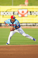 Tennessee Smokies shortstop Addison Russell (4) makes a throw to first base against the Mississippi Braves at Smokies Park on July 22, 2014 in Kodak, Tennessee.  The Smokies defeated the Braves 8-7 in 10 innings. (Brian Westerholt/Four Seam Images)